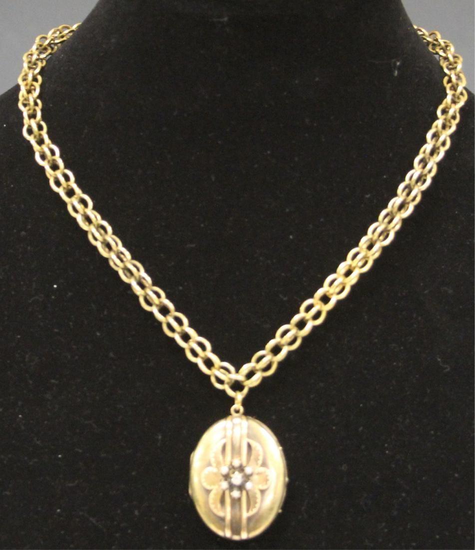 18KT GOLD LOCKET WITH DIAMOND