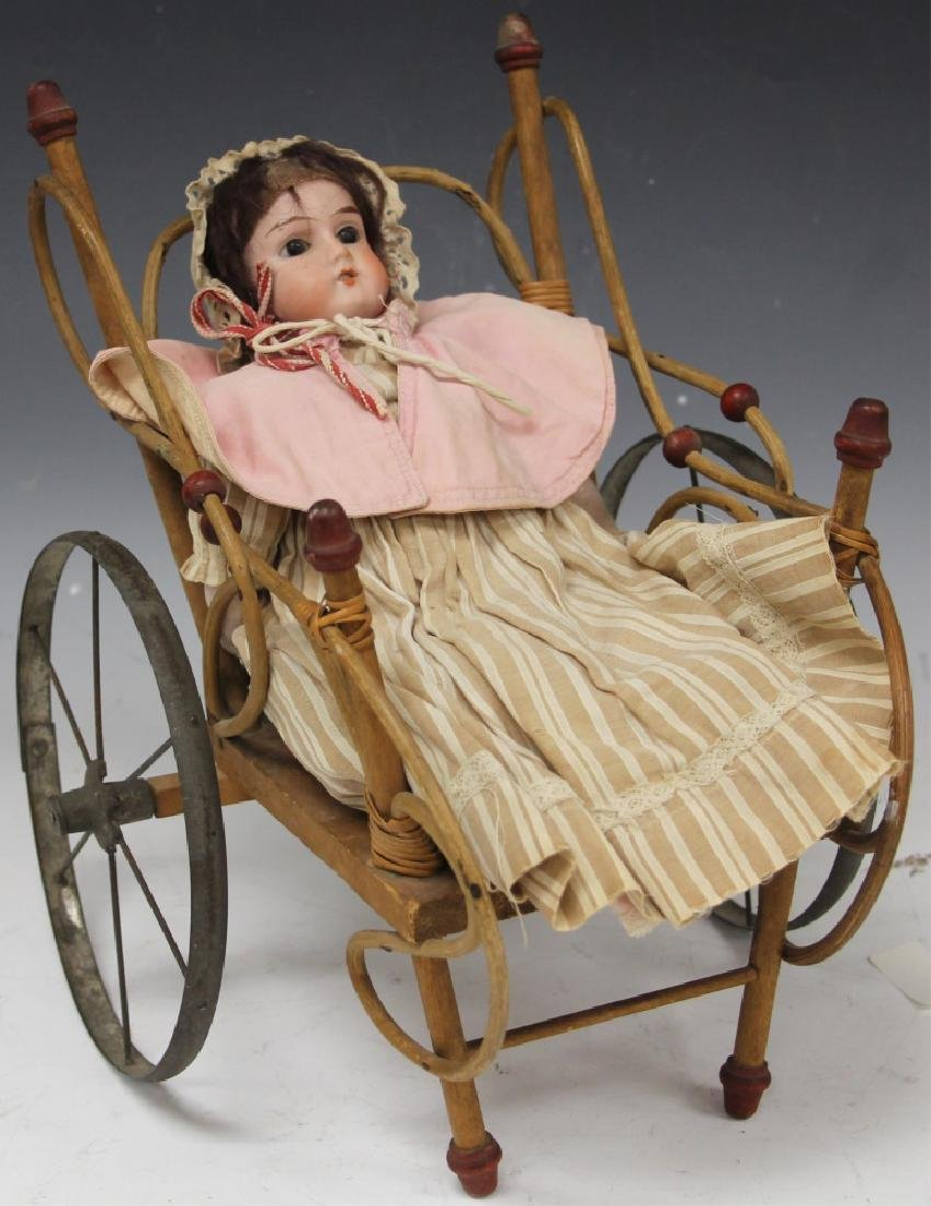 VINTAGE GERMAN PORCELAIN DOLL WITH WICKER BUGGY