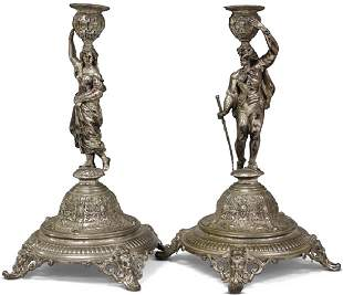 PAIR OF SILVER CONTINENTAL FIGURAL CANDLE STANDS