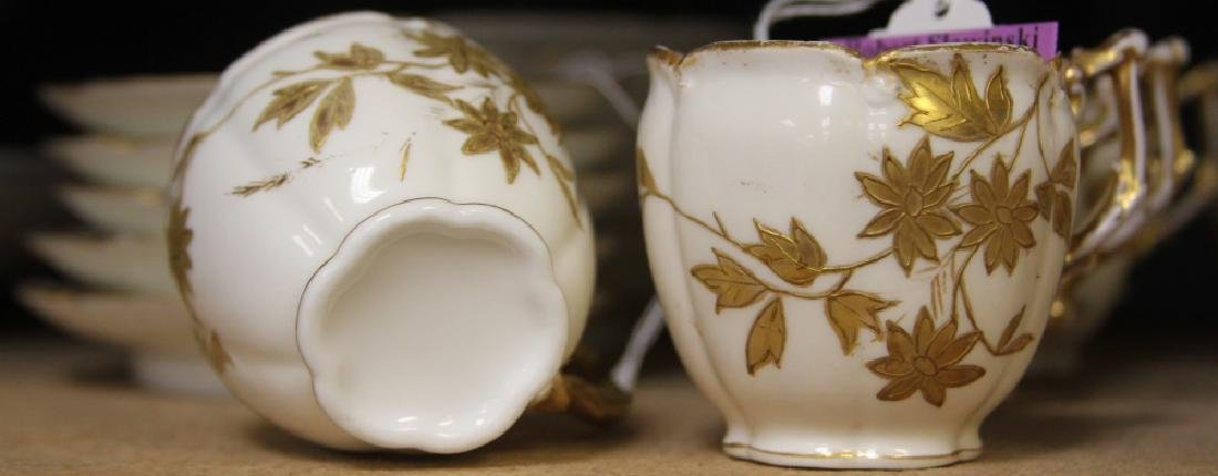 SET OF UNMARKED DEMITASSE CUPS AND SAUCERS - 3