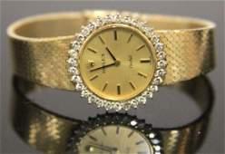 LADY'S VINTAGE DIAMOND 18KT GOLD ROLEX WATCH