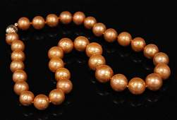 LADYS GOLDEN PEARL NECKLACE W/ 14KT CLASP