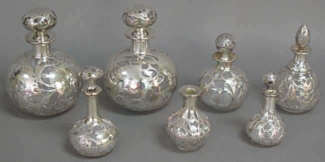 500: LOT OF (7) SILVER OVERLAY BOTTLES early 20th centu