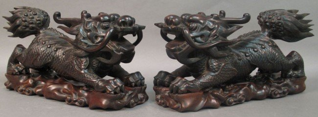 84: PAIR OF CHINESE CARVED WOOD FOO DOGS with stands le