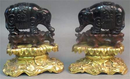 57: PAIR OF CHINESE AMBER CARVED ELEPHANTS ON STANDS le