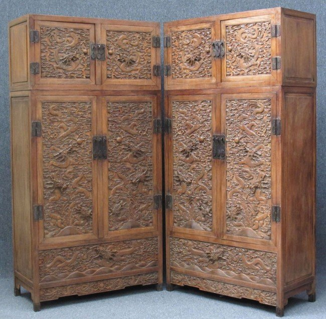 77: PAIR OF CHINESE CARVED WOOD CABINETS with five toed