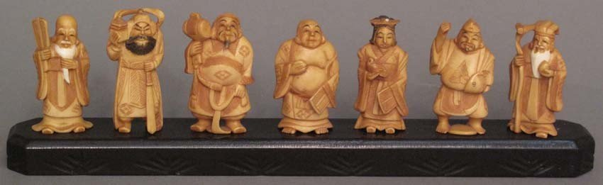 11: LOT OF (7) CARVED IVORY FIGURES with stand height: