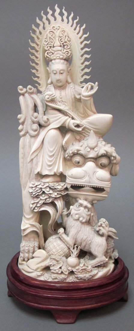 13: CHINESE CARVED FIGURE OF QUAN YIN with foo dog late