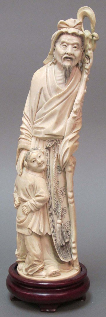 14: CHINESE CARVED FIGURE OF MAN with child signed, 19t