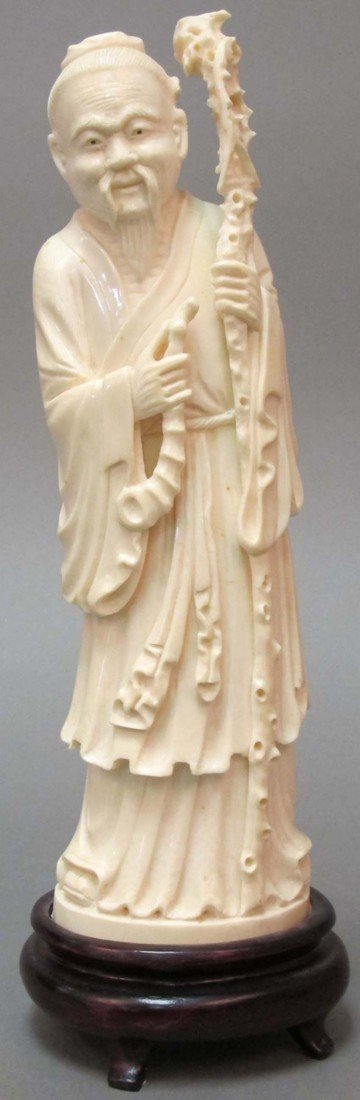17: CHINESE CARVED IVORY FIGURE with staff height of iv