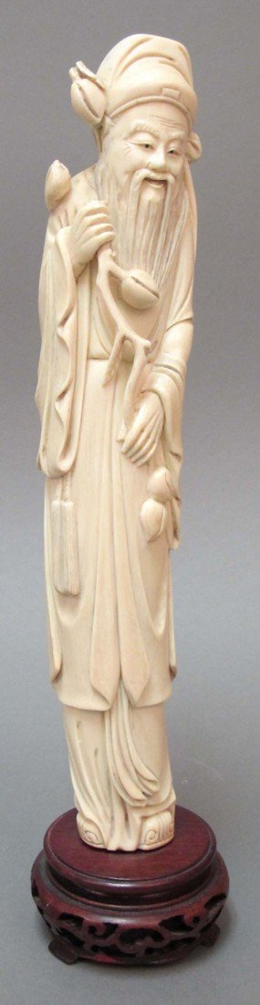 "21: CHINESE CARVED IVORY FIGURE height: 11 3/4"" note: l"