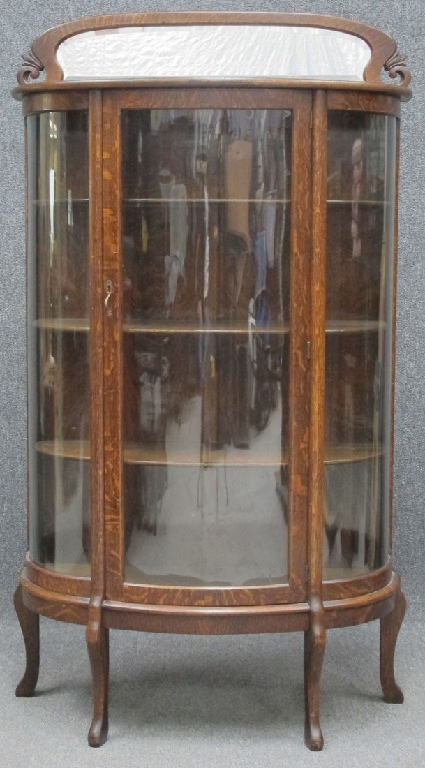 364: EARLY 20TH CENTURY OAK CURVED GLASS CHINA CABINET