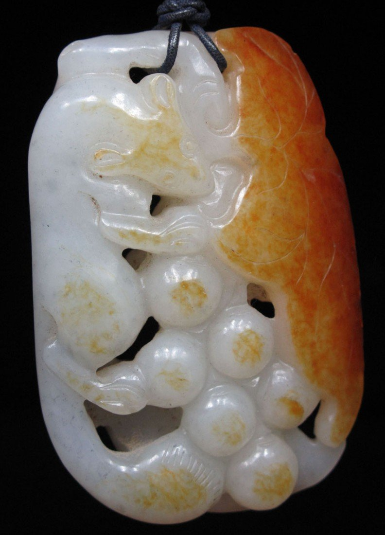 CHINESE CARVED JADE PENDANT with orange blossom