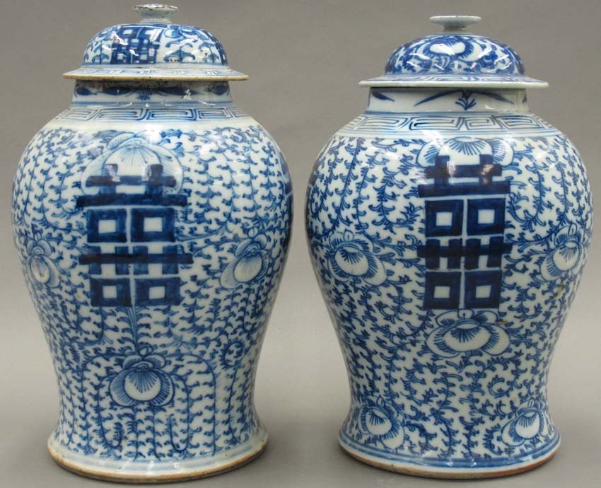PAIR OF BLUE AND WHITE PORCELAIN COVERED VASES