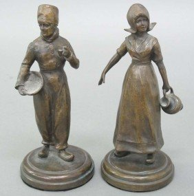 PAIR OF BRONZE CONTINENTAL FIGURAL STATUES sign