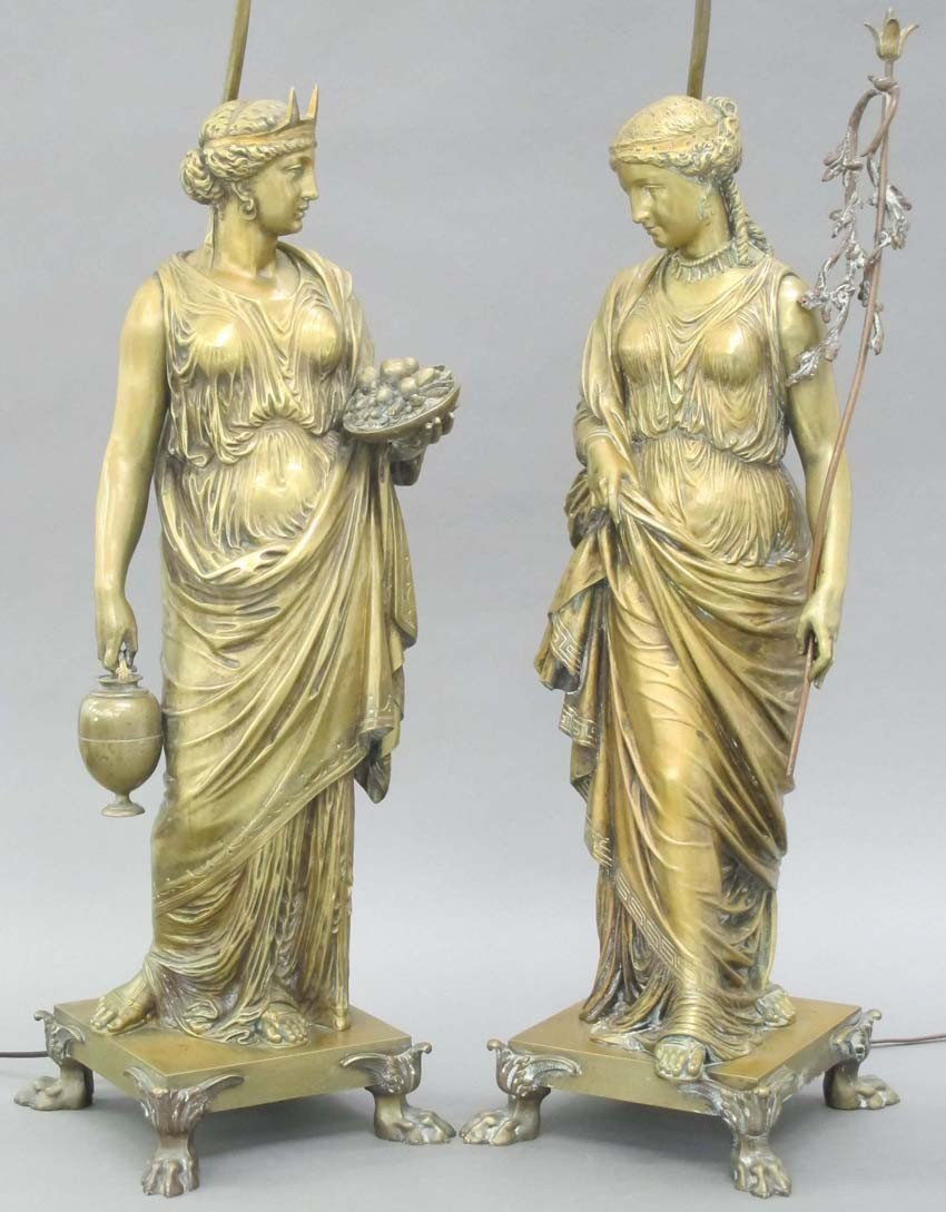 PAIR OF BRONZE STATUES MODELED AFTER THE STATUE