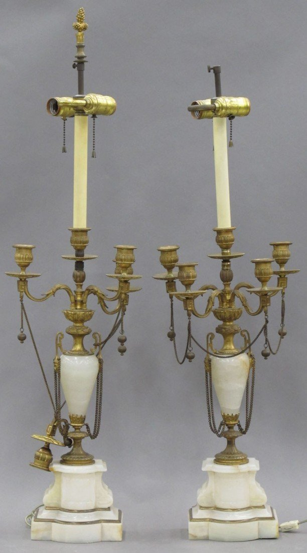 PAIR OF FRENCH ONYX AND GILT METAL CANDLEABRAS