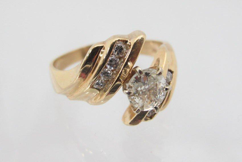 9179B: 14KT DIAMOND RING