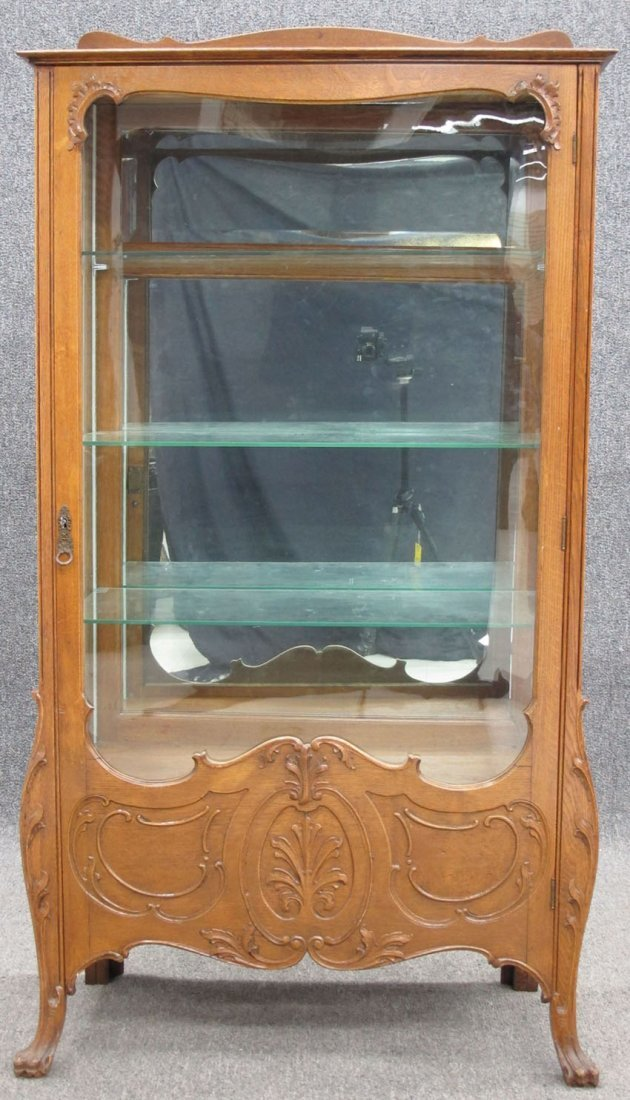 9134: AMERICAN OAK CHINA CABINET with claw feet height-
