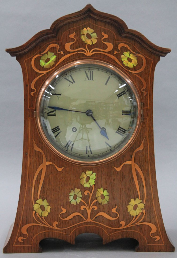 ARTS AND CRAFTS OAK MANTLE CLOCK with brass and