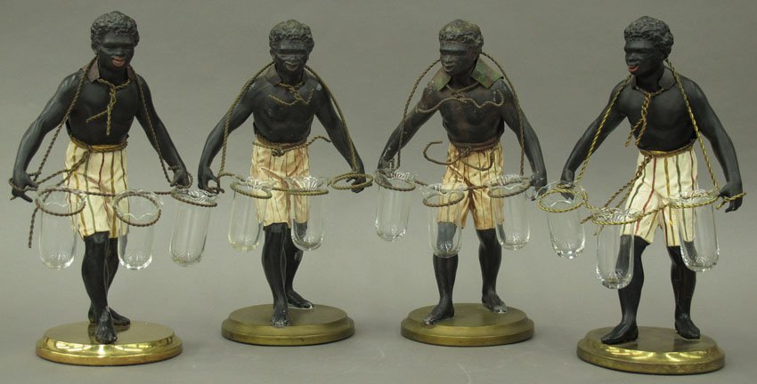 SET OF (4) FRENCH COLONIAL STATUES with tulip