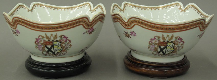 PAIR OF CONTINENTAL PORCELAIN BOWLS with stands