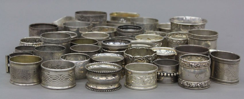 7001: LOT OF (45) STERLING SILVER NAPKIN RING HOLDERS