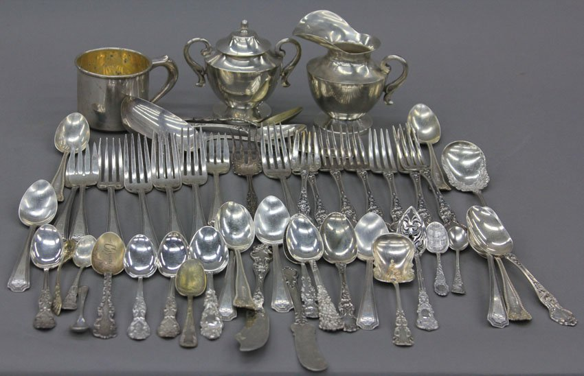 7002: LARGE ASSORTMENT OF STERLING SILVER flatware, so
