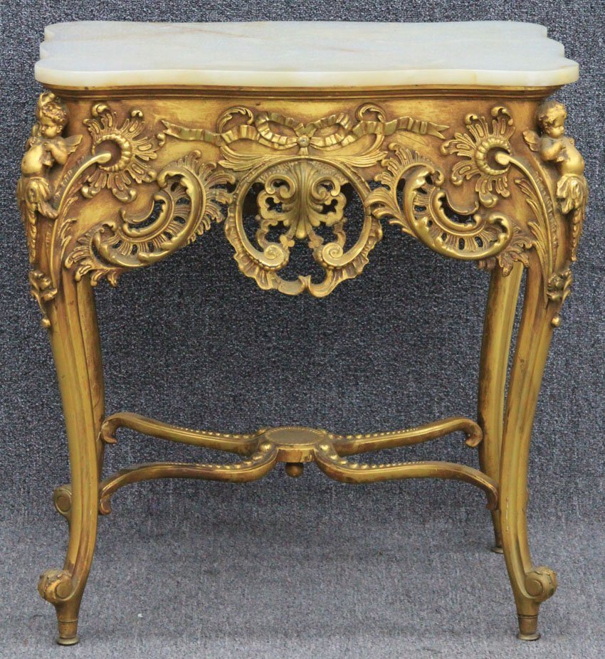 7023: LATE VICTORIAN FRENCH SIDE TABLE with carved fig