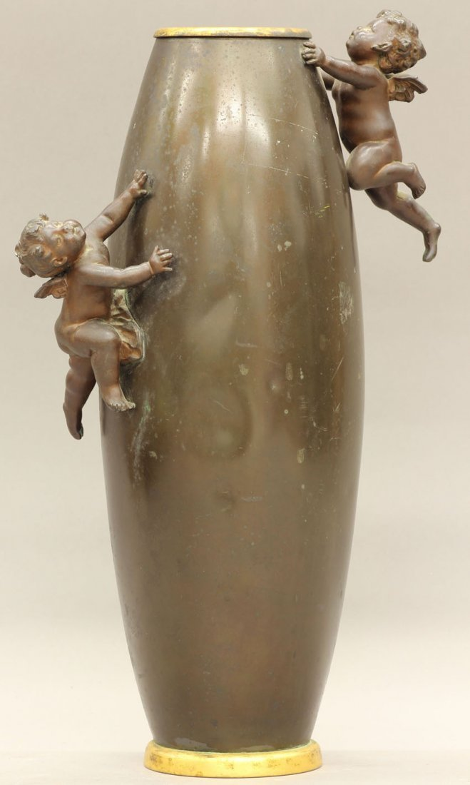 7957: LATE VICTORIAN CAST METAL VASE with cast metal ch