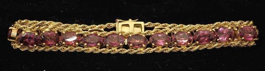 8486: LADIES 14KT YELLOW GOLD BRACELET with (21) rhodol