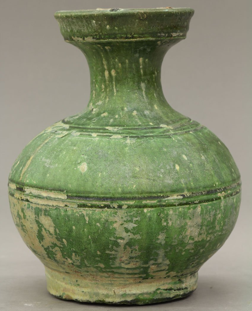 8501: EARLY CHINESE POTTERY VESSEL with green mat finis