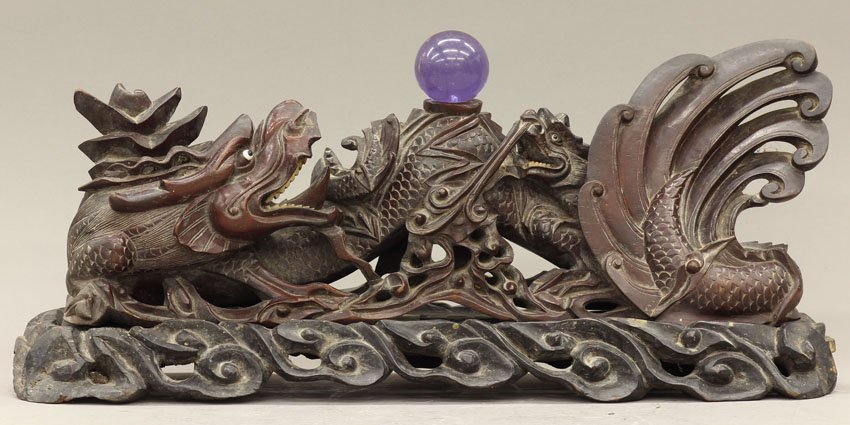 8506: CHINESE CARVING OF DRAGONS on wood stand circa ea