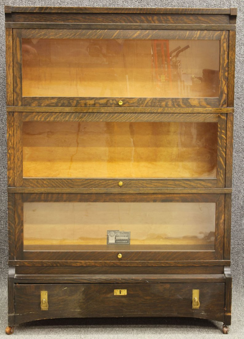 AMERICAN ARTS AND CRAFTS OAK STACKING BOOKCASE with dra