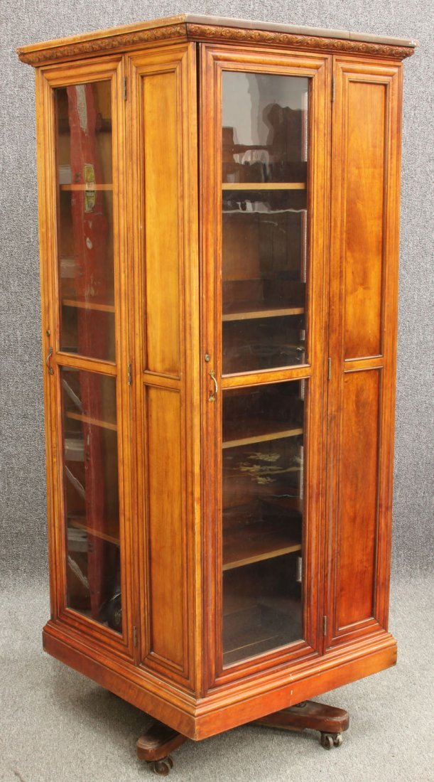 VICTORIAN CHERRY REVOLVING BOOKCASE, marked Danner with