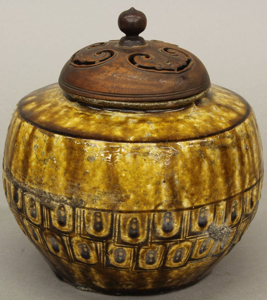 VINTAGE CHINESE POTTERY VESSEL with carved wood top