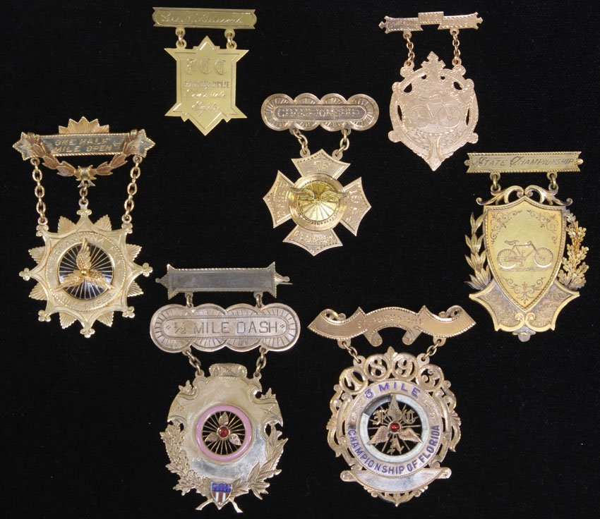 COLLECTION OF (7) GOLD VINTAGE BICYCLE MEDALS