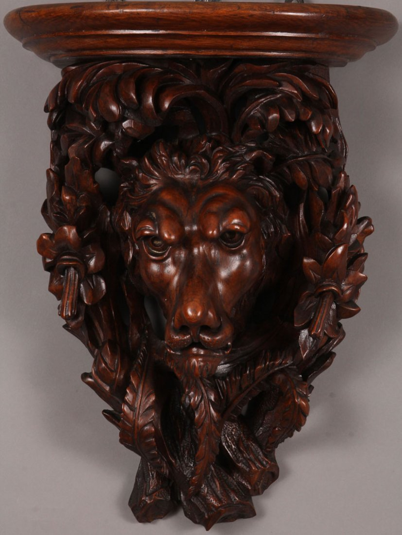 CONTINENTAL CARVED WALNUT WALL SCONCE OF LION