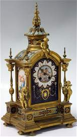 FRENCH CHAMPLEVE DORE BRONZE AND PORCELAIN CLOCK