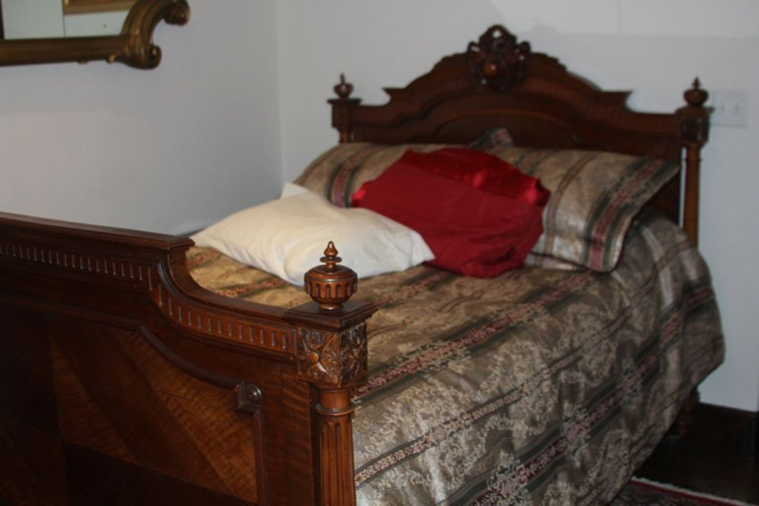 CONTINENTAL 19TH CENTURY CARVED WALNUT BED