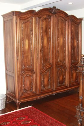 French Provincial Style Carved Walnut Armoires