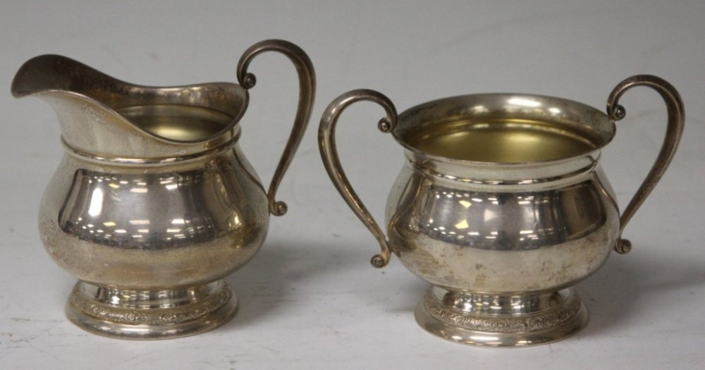 PAIR OF STERLING SILVER INTERNATIONAL PITCHERS