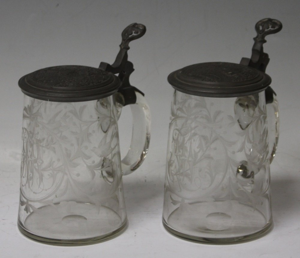 PAIR OF 19TH CENTURY ETCHED GLASS STEINS