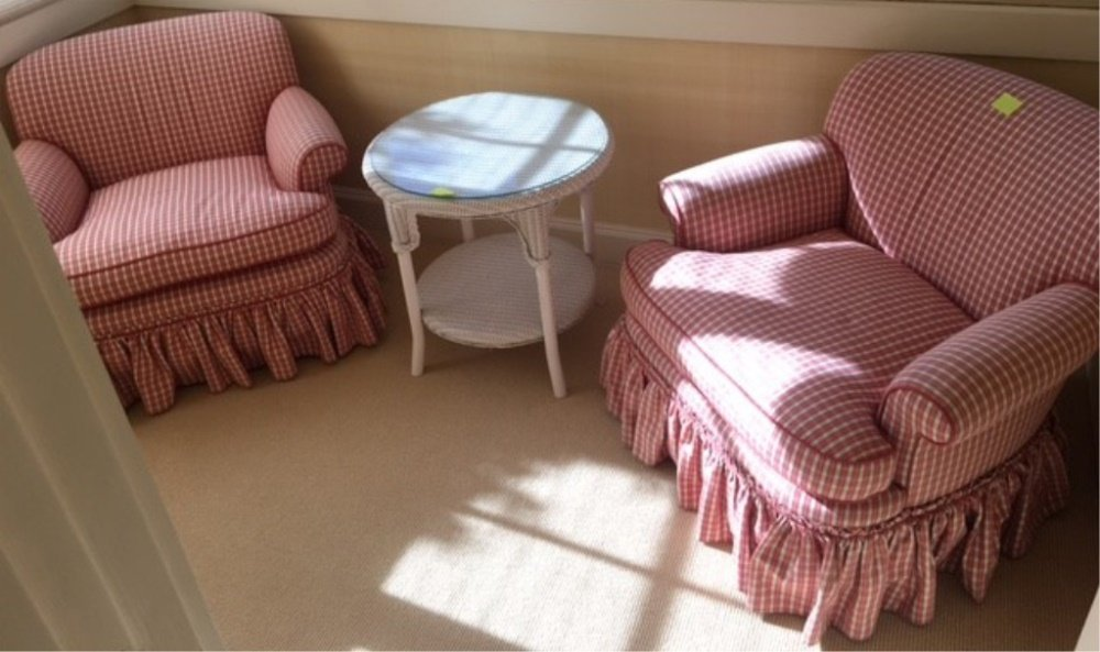 PAIR OF PINK DESIGNER CHAIRS WITH WICKER TABLE