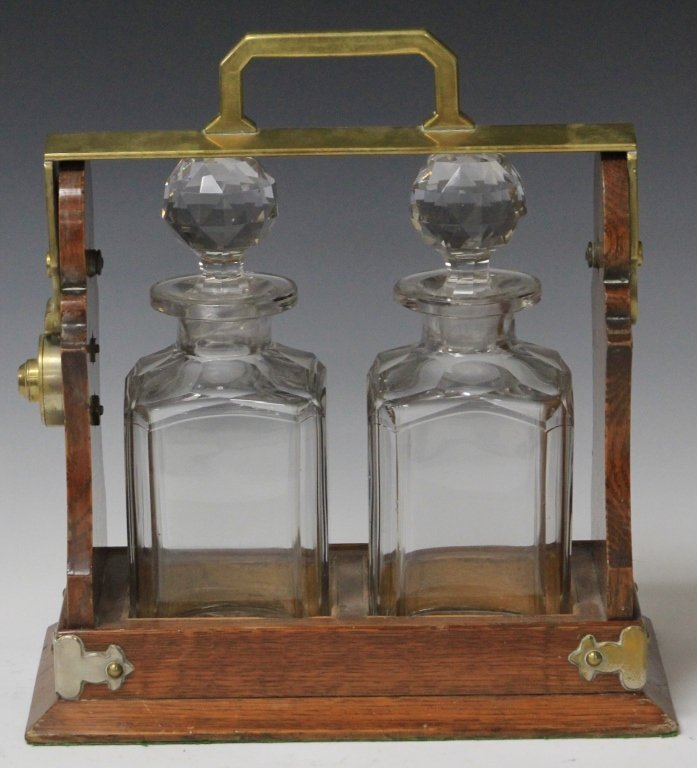 EARLY 20TH CENTURY TWO-BOTTLE TANTALUS SET