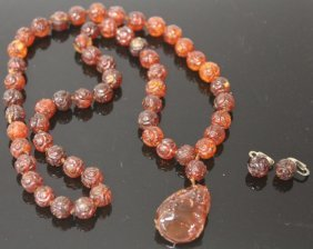 EARLY CHINESE CARVED AMBER NECKLACE AND EARRINGS