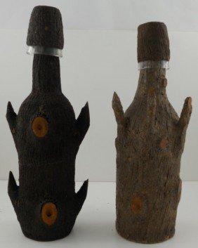 20: Pair of Primitive Bark Covered Bottles