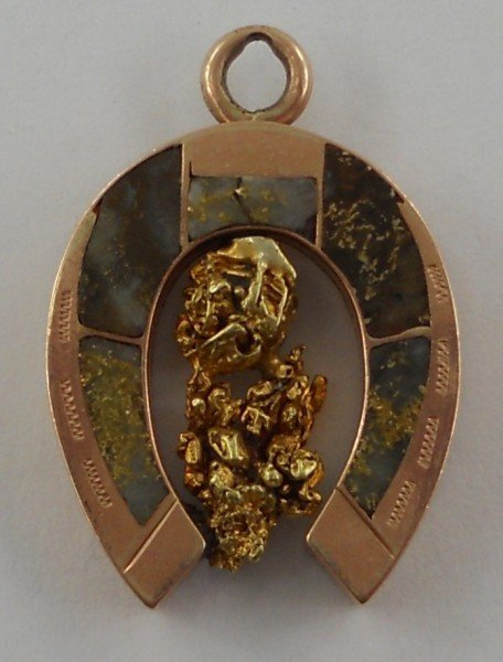 268: Rose Gold Horseshoe-Shaped Pendant with Nugget