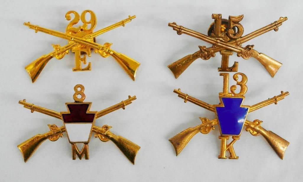 Four (4) Spanish-American War Hat Badges
