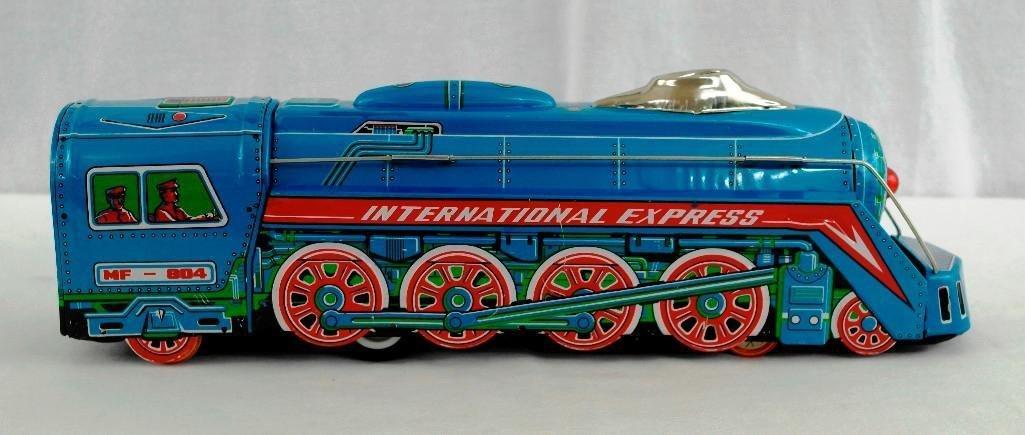 2 Tin litho Toys - International Express Locomotive And - 2